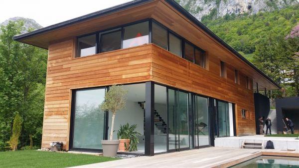 construction d 39 une villa contemporaine en bordure du lac d. Black Bedroom Furniture Sets. Home Design Ideas